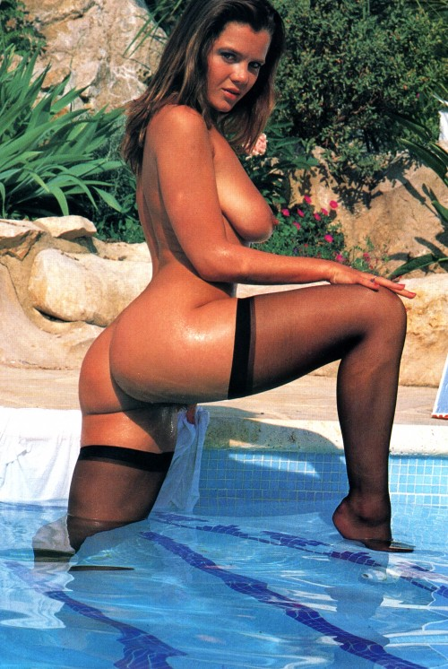 Naked-in-black-stockings-at-the-pool.jpg