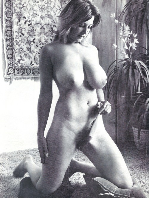 Blonde-with-huge-boobs-takes-care-of-her-pussy.jpg